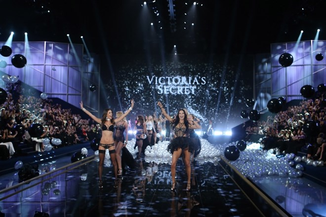 Alessandra Ambrosio, left, and Adriana Lima display creations with other models at the end of the Victoria's Secret fashion...