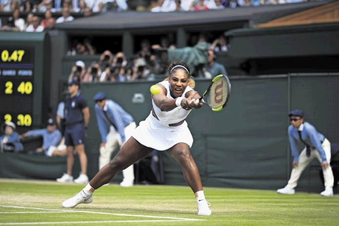 United States' Serena Williams returns to Czech Republic's Barbora Strycova in a Women's semifinal singles match on day ten...