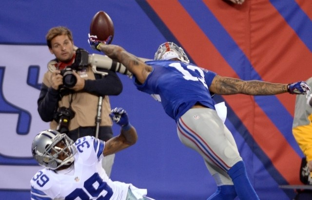 Odell Beckham je na neverjeten način uspel ujeti žogo in doseči touchdown za NY Giants. (Foto: USA TODAY Sports / Reuters)