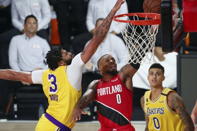 Anthony Davis in Damian Lillard.