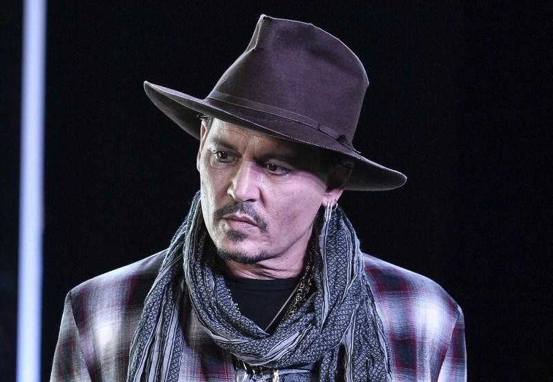 Johnny Depp pravi, da nasilen ni bil on, ampak njegova nekdanja žena